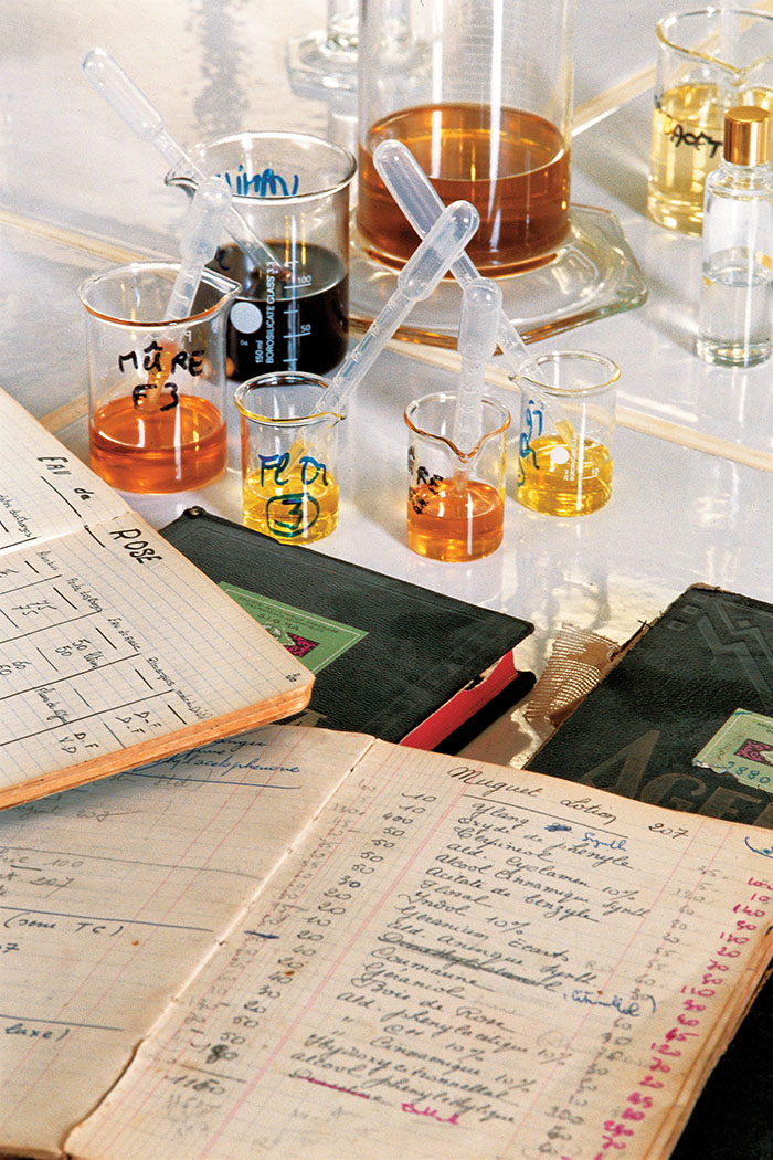Perfumers mix hundreds of ingredients to create a new scent, keeping detailed notes for reference.