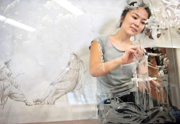 At work in Vancouver, BC, Tomoki Gomez is part of a new generation of decorative artists emerging from Gorman Studios. Here she is creating an églomisé wall panel, also known as reverse painted glass, for a residence in New York City.