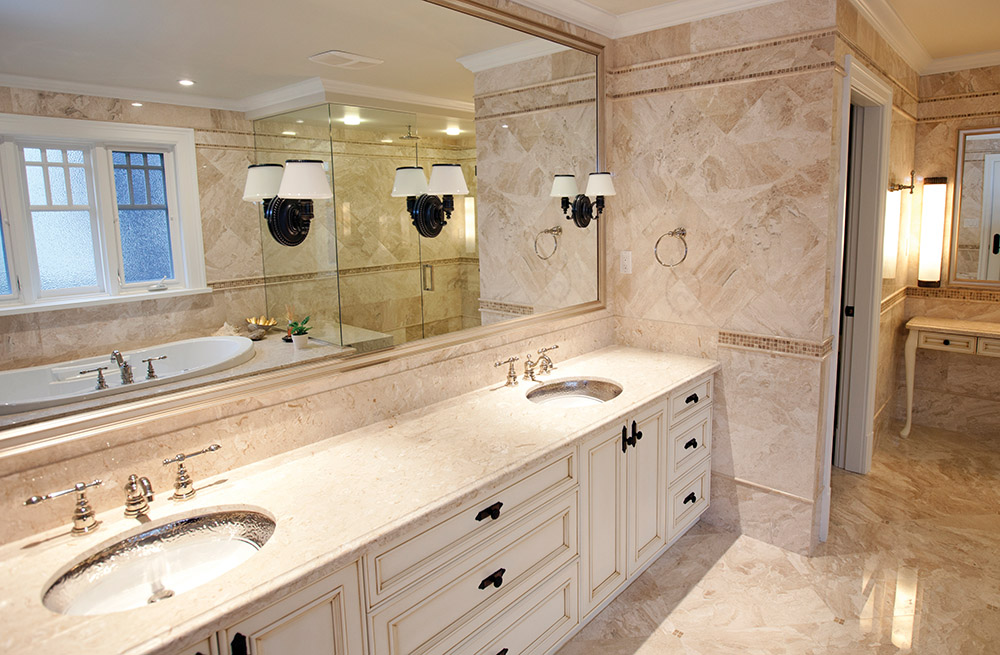 A single marble was applied over almost every surface in the master bathroom for a luxurious effect.