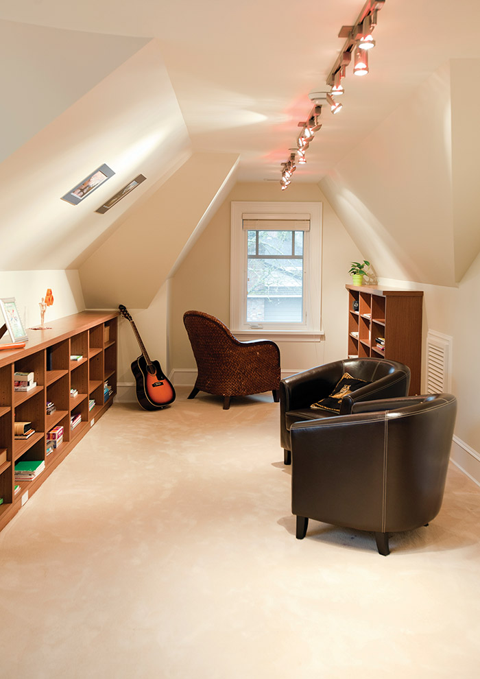 Comfortable chairs and ample light (both artificial and natural) make this top floor recreation room ideal for playing the guitar or reading.