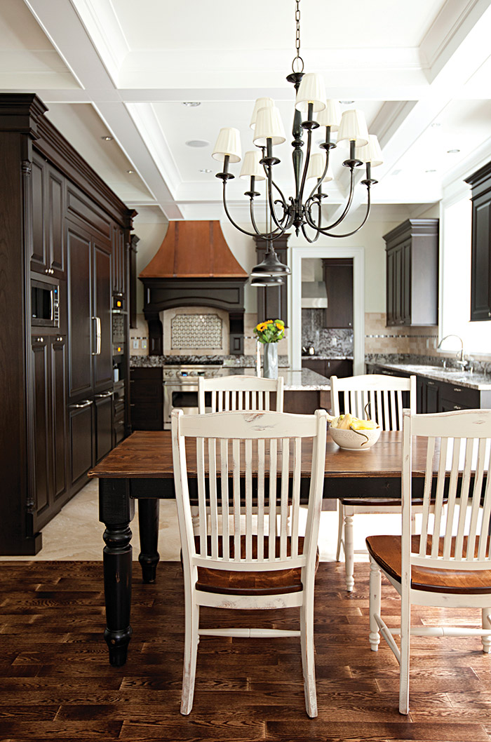 Dark cabinetry sets this kitchen apart. Off the main area, an Asian kitchen is where the owners do their wok cooking.