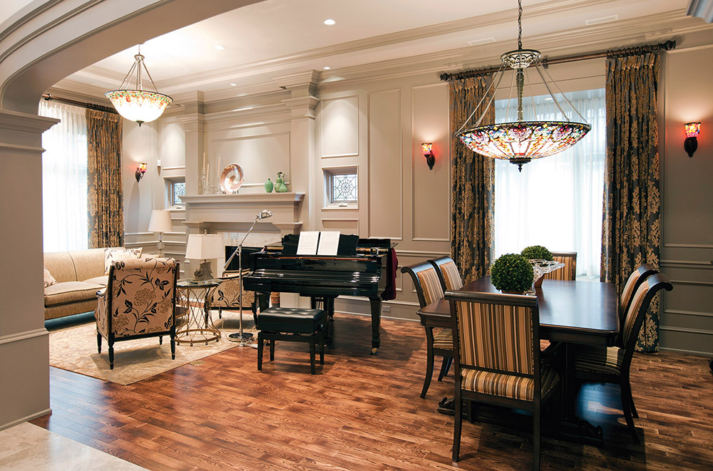 The custom-designed lead art glass windows echo the front door and are common in heritage homes. Oak flooring from Quebec grounds the living room and is a warm complement to the marble foyer.