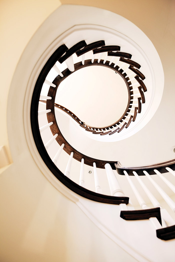A circular staircase in the foyer is a labour-intensive — but striking — design feature.