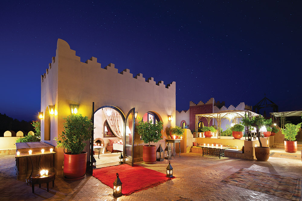 The roof terrace at the Kasbah Tamadot comes alive in the evening as you meet your fellow guests over a cocktail and listen to the dulcet ululations of the hotel's guembri player (a type of traditional Moroccan guitar).