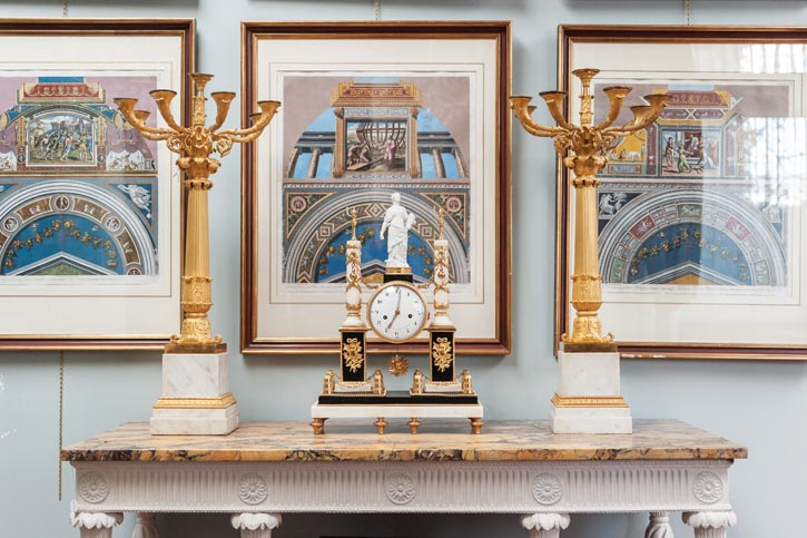 the second of these gilt candelabras was acquired 35 years after the first.