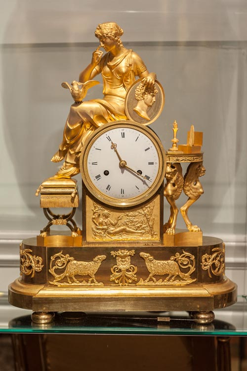 a clock encased in a gilded sculpture of the Greek god Hippolytus.