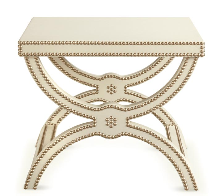 Baker Alexandre Stool, Price Upon Request Bronze nail trims anchor an ivory leather pad to a form which offers ancient Greek purity re-envisioned in a French Neoclassic design. Suitable as stool or small table. At Brougham Interiors, 604 736 8822 broughaminteriors.com