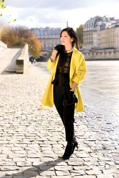 Yellow coat Vionnet Green and red bracelet Dsquared2 Black trousers Michael Kors Black capri-pants Dsquared2 Black horse fur ankle boots Tod's