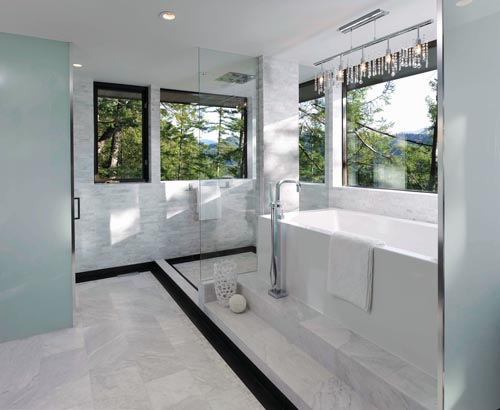 Lavish use of marble and a glittering chandelier give the ensuite a luxurious, spa-like ambience.