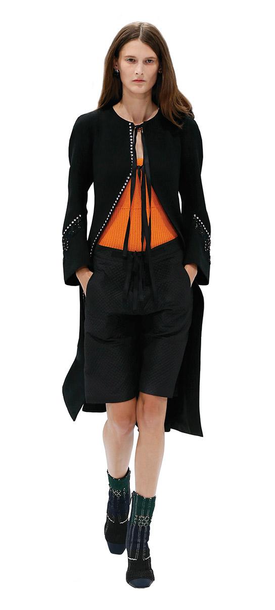 dire black coat fashion orange shirt
