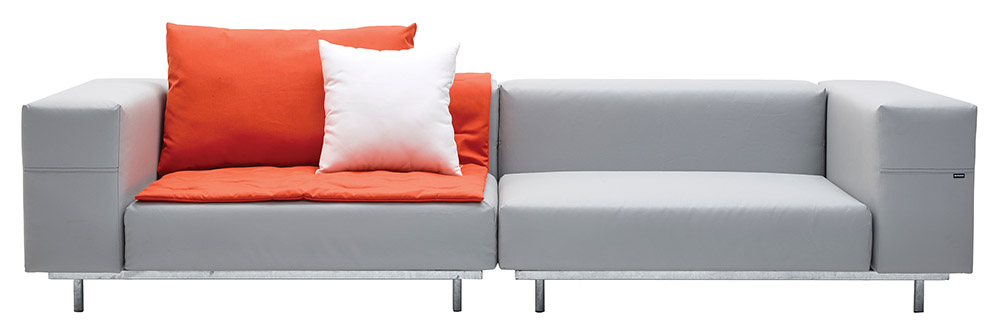 gray sofa punchy orange pillows and throw