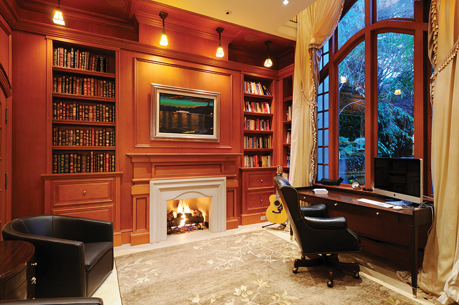 Windows soar a full two storeys in the richly wooded library.