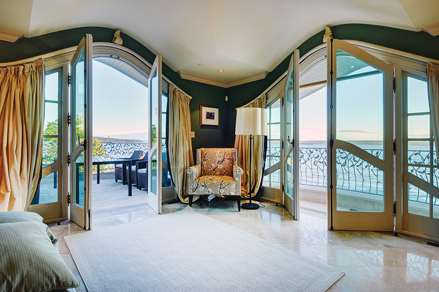 Three sets of double French doors allow ocean breezes to fill the master bedroom's private sitting area.