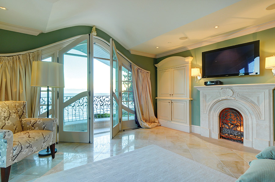Celebrating its seaside location, the master bedroom's fireplace surround incorporates a seashell motif.