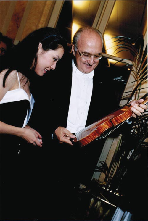 Admiring a Stradivari violin with Salvatore Accardo, President of the Marguerite Long-Jacques Thibaud International Violin Competition's jury.