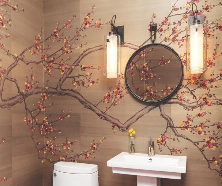 Lively plum blossoms, half-painted, half-embroidered with silk thread on hand-painted silk wallpaper by London-based Fromental glamorize this otherwise stark powder room.