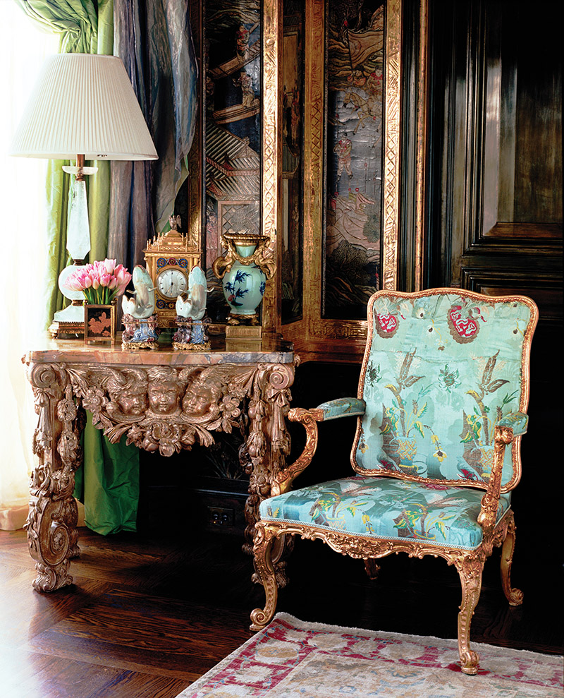 Antique giltwood armchair with Coromandel screen-paneled walls.