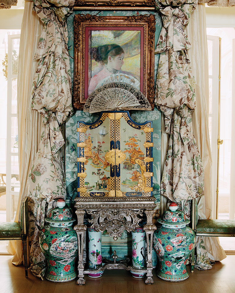 The gift that started it all: a German Baroque white and blue-lacquered cabinet on stand in Mrs. Getty's bedroom.