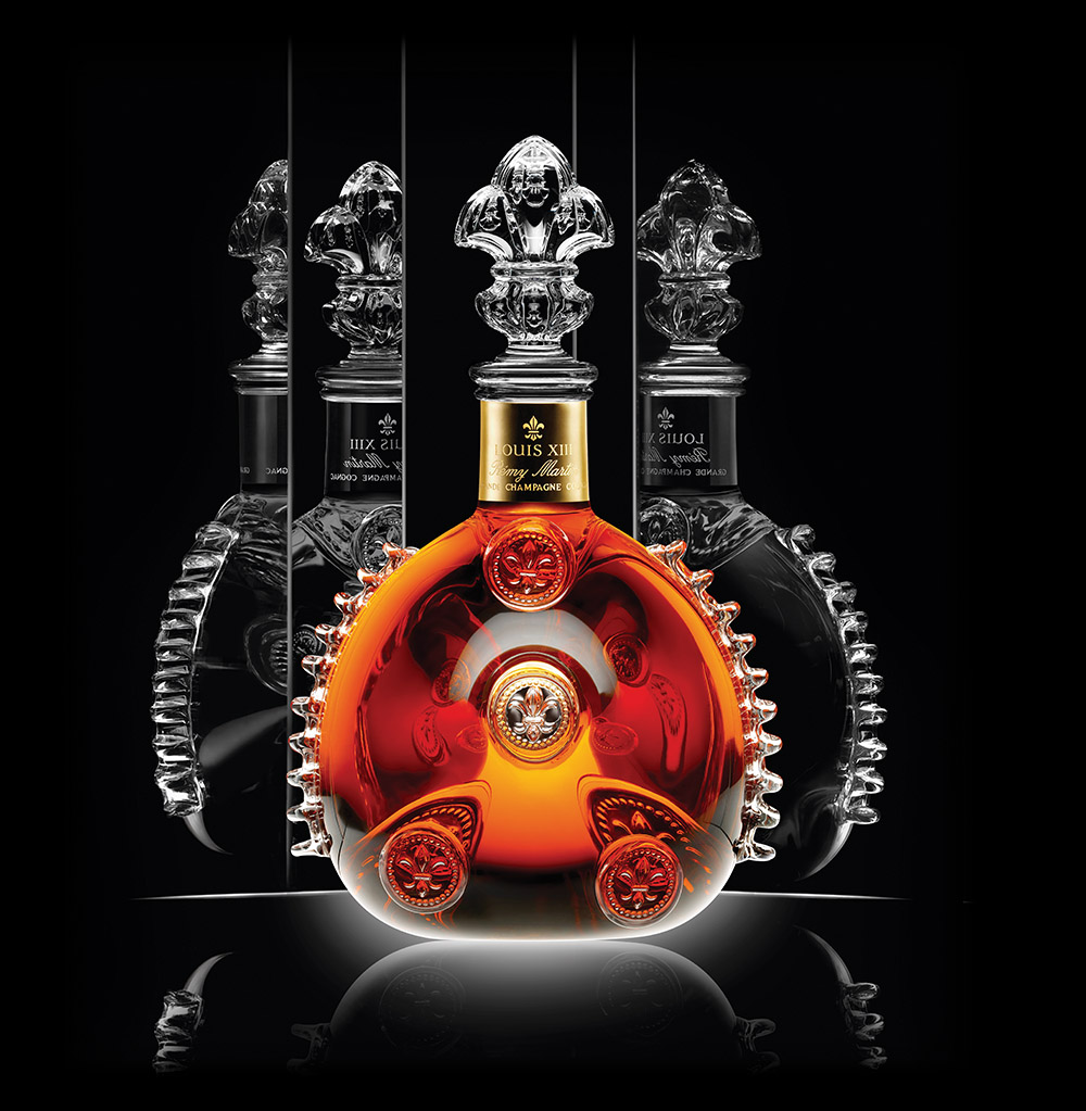 A bottle of Louis XIII Cognac from the prestigious house of Remy Martin containing Grande Champagne eau de vie aged