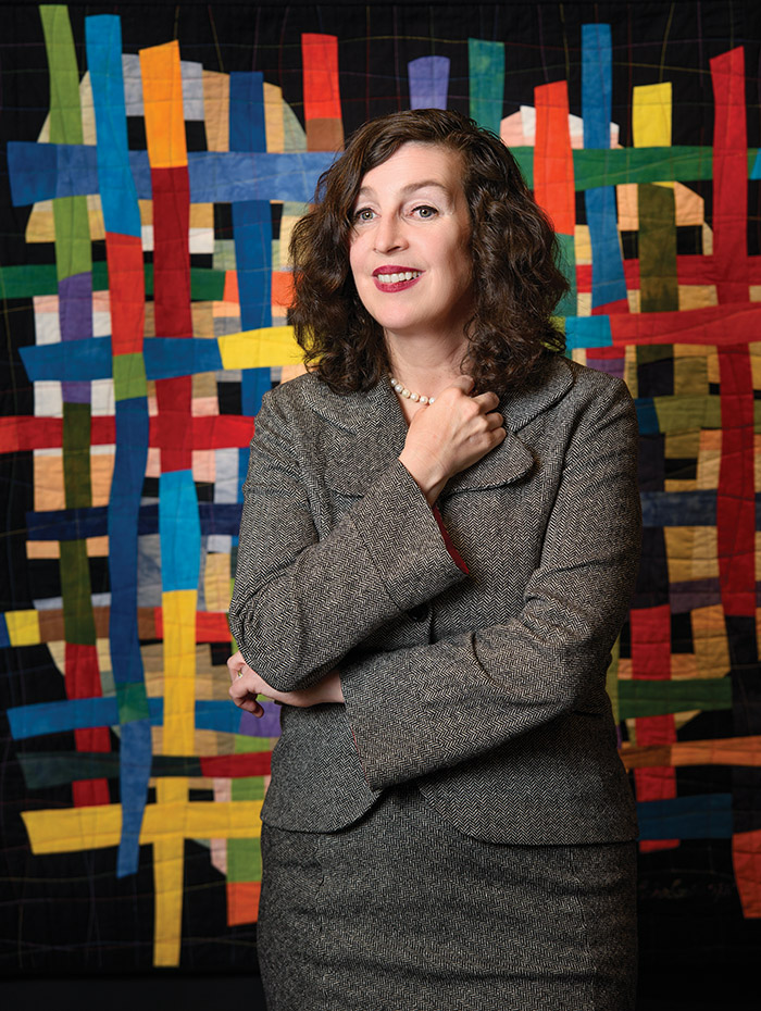 Angela Clarke in front of a textile piece of art at the Il Museo, at the Italian Cultural Centre in Vancouver.