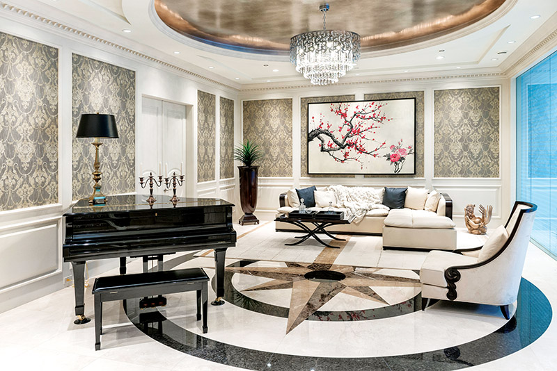 A throwback to Vegas glamour, the piano lounge is finished with marble mosaic floor and luxurious Christopher Guy sectional.