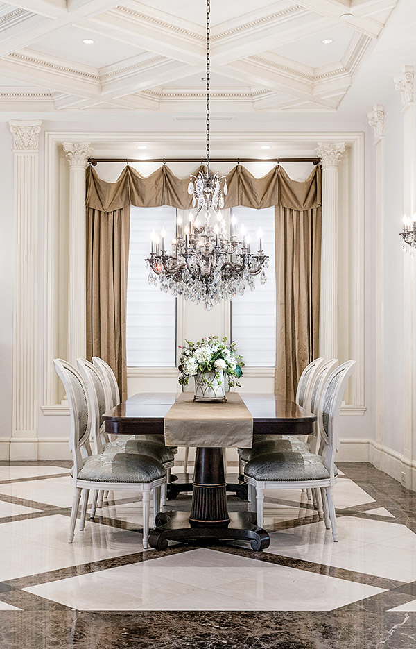 Through a formal arched entry, the dining room is an eloquent space to wine and dine, with custom mahogany table and Lillian August chairs covered in Italian silk.