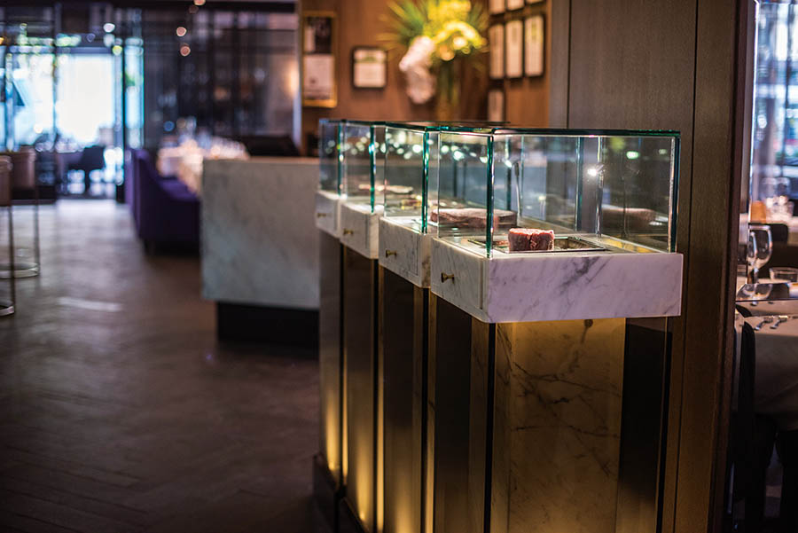 Steaks take the spotlight in marble-and-glass displays inspired by jewelry stores.