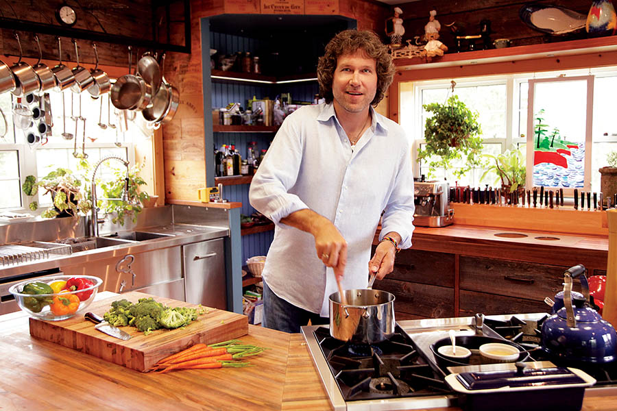 Michael Smith in his home kitchen on Prince Edward Island, where he runs a cooking show and prepares food for the family.