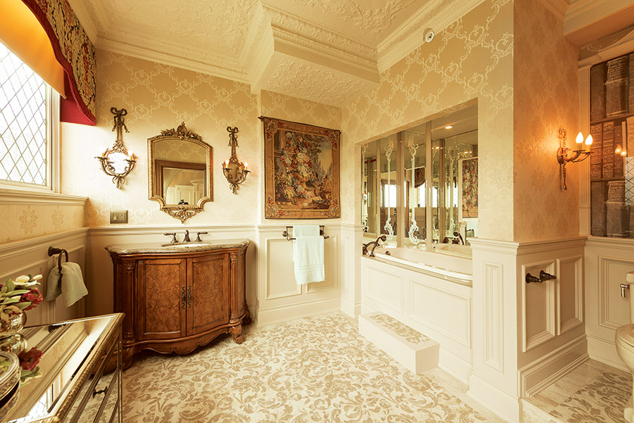 Simply divine, the guest boudoir features a step-up tub surrounded by etched glass mirrors and imported silk damask and flocked velvet wallpaper.