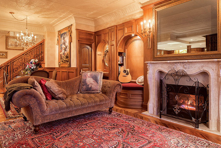 The front sitting room, with its Victorian­style chaise, is a marriage of design eras. The panelled feature wall resembles the first­class smoking room of the 1912 RMS Titanic, while the MirrorVue TV is a modern­day luxury.