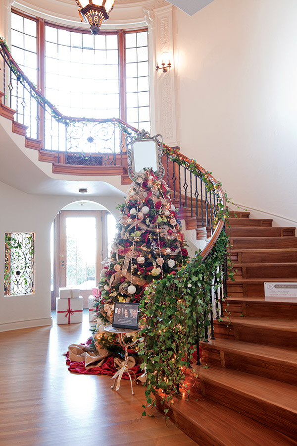 A decorated tree awaits at every corner, including this one, bedazzled by designer Danielle Molnar at the foot of the grand staircase.