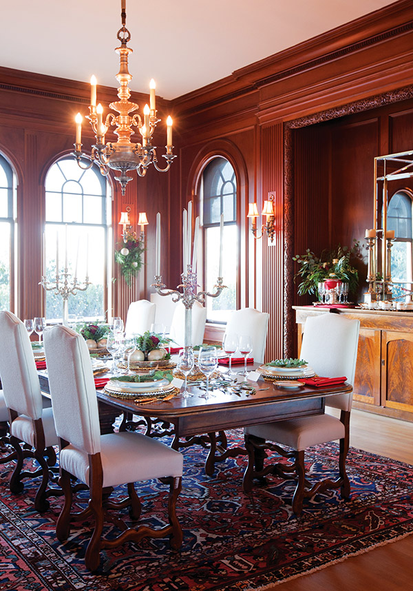 An exquisite dining room with a 14-foot-high ceiling and hand-carved millwork is the regal setting where original owner George C. Reifel would carve the family's Christmas turkey in the 1930s.