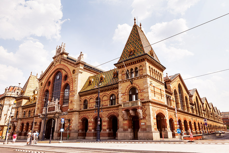 The Central Market Hall, Budapest's oldest and largest, is a treasure chest of foodie delights. (Exterior view: Oscity / Shutterstock.com)