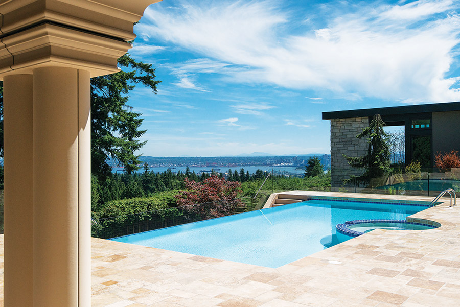 A travertine deck is elevated 40 feet above the street, with a gorgeous infinity pool producing the enchanting visual effect of water extending to the horizon.