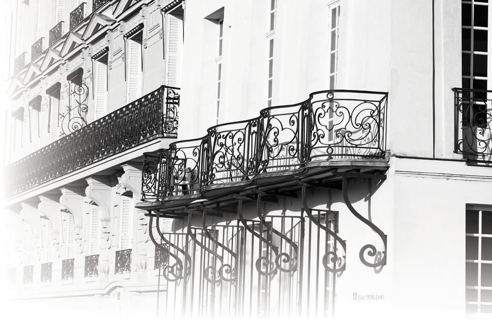 Balcony windows of a house, Seine river wharf, Louise Island in Paris