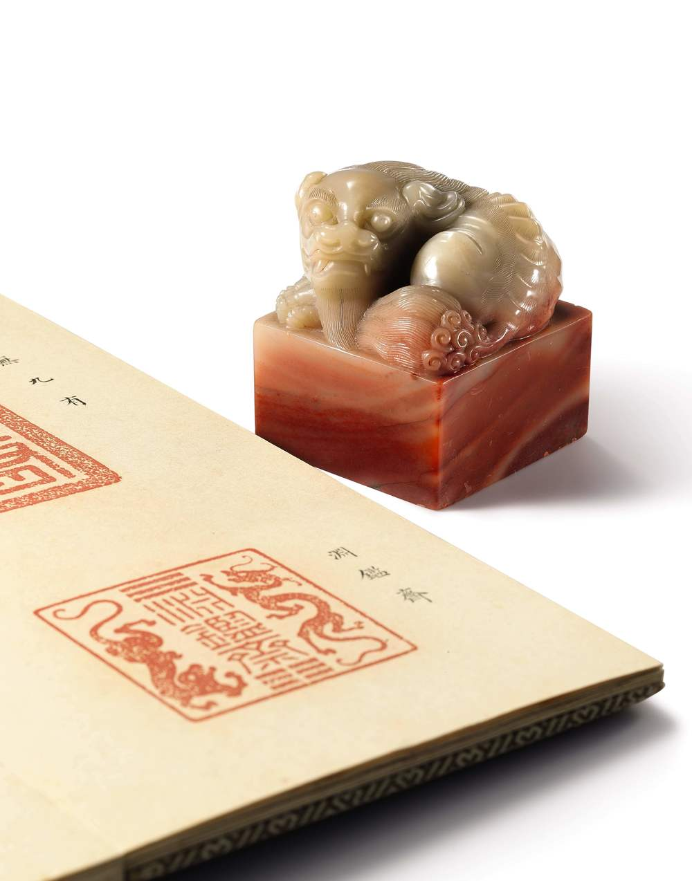 The soapstone seal is carved with the characters of the Yuanjianzhai ('Studio of Profound Discernment), the Kangxi Emperor's favourite personal retreat in the Imperial gardens northwest of Beijing, the studio where he cultivated his passion for calligraphy and research into Western science and art. The carving is of superlative quality, and is exceptional for featuring a dragon and a tiger in addition to mystical trigrams, a specific combination for evoking his status as the unsurpassed ruler of heaven and earth. The unusual positioning of the seal text between double dragons on this seal is a feature that was specifically commented on by Jean-François Gerbillon, the famous Jesuit missionary and close confidant of the emperor, when he was invited to inspect the Emperor's seals in 1690 in the Yangxindian. (Image: Sotheby's)