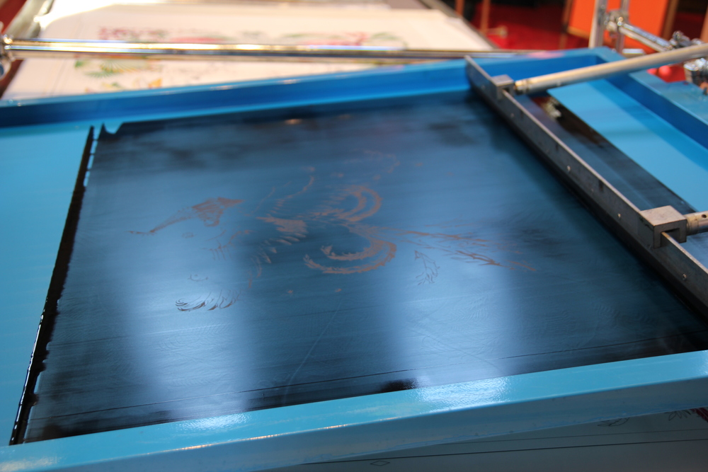 A silk-screen machine used to apply Hermès custom-made ink to the scarves. (KaYan Wong/Taste of Life)