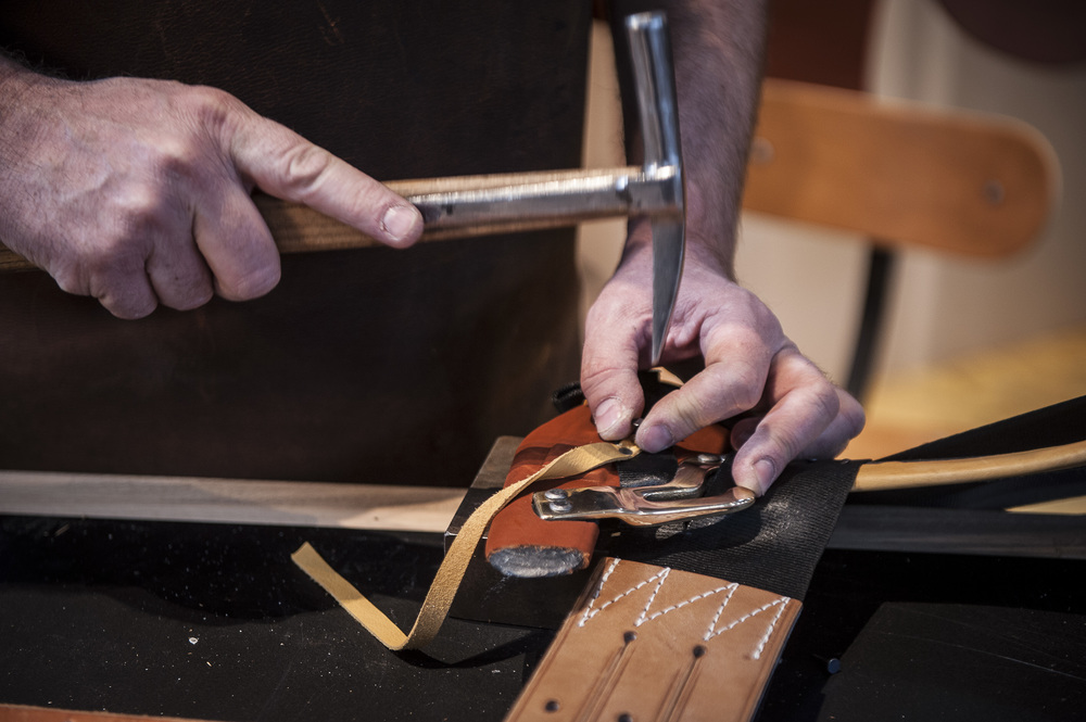 A Hermès craftsman works with leather and metal. (Courtesy Hermès)