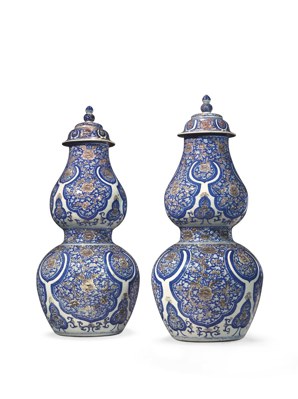 Two Kangxi Period (1662-1722) Chinese porcelain double-gourd vases with covers are impressive at 43 ¾ inches tall. They come to Christie's as part of an American family's collection.  Estimate: $200,000 to $300,000.  (PHOTO CREDIT: CHRISTIE'S IMAGES LTD. 2016)