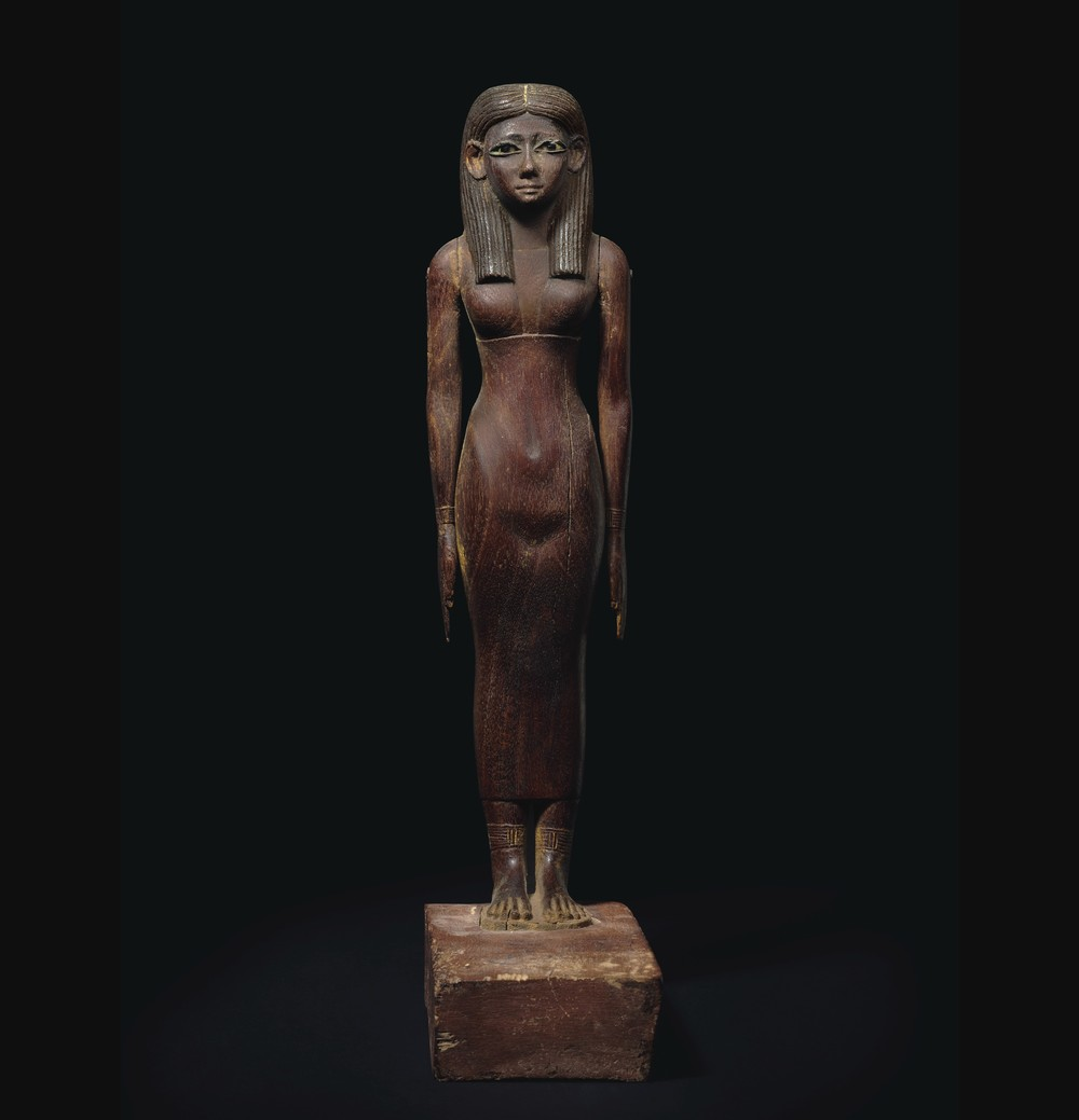 "An exceptional Egyptian wood carving of a lady produced almost 2 millennia before Christ: during the early 12th dynasty of Egypt, circa 1981 - 1802 B.C.  Max Bernheimer, international head of department for world art at Christie's, said this exotic hardwood figure is the ideal of feminine beauty for that period, and in his 25 year career this object falls into the top 10, if not top five, ""a masterpiece."" The figure's eyes are framed with copper, set with limestone and obsidian pupils.  Estimate: $500,000 to $700,000.  (PHOTO CREDIT: CHRISTIE'S IMAGES LTD. 2016)"