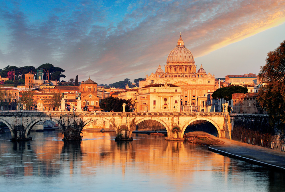 Ponte Sant'Angelo and St. Peter's Basilica in Vatican City illustrate classical Greek influences in Roman architecture, especially the use of the divine sphere and the earthly square. ( TTstudio / Shutterstock.com)