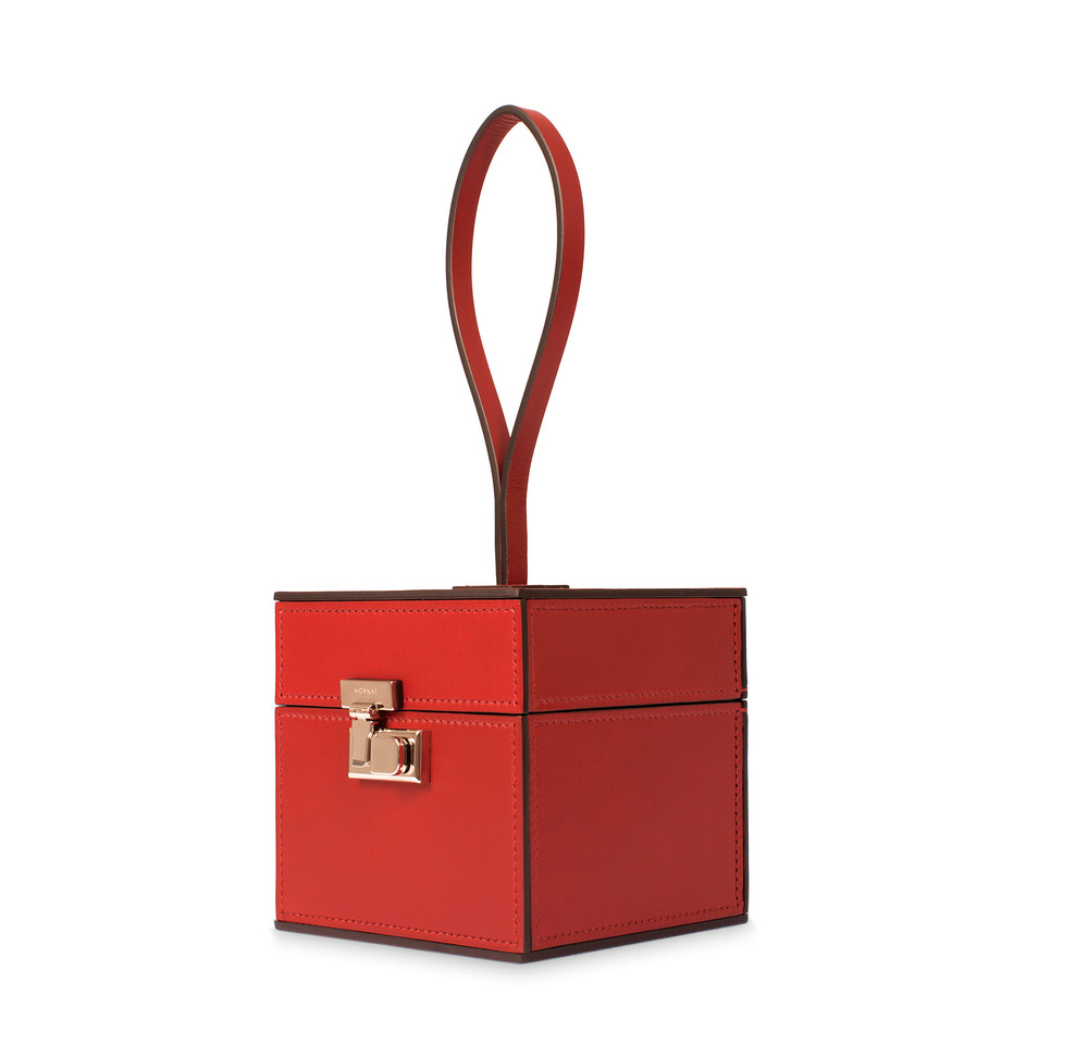 A lacquer-red vintage vanity case is nostalgic fashion embodied. Photos courtesy of Moynat