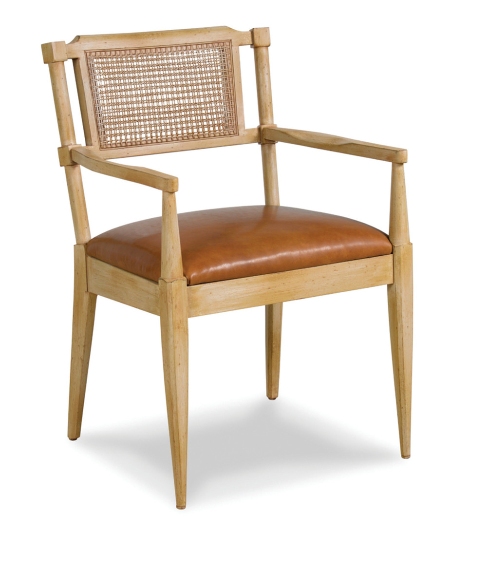 """A furniture fave is the simple Saltworks chair he designed for Schumacher, along with the icy """"Cap Ferrat"""" fabric he used to drape the walls of his Paris bedroom."""