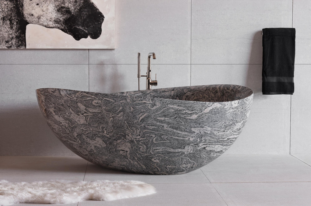 "Stone Forest  papiillon bathtub in cumulo granite  is carved entirely by hand from a single piece of stone, 26""h x 68""w x 44""d, $25,500,  stoneforest.com , (888) 682-2987"