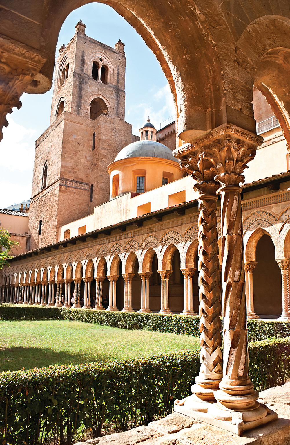 The cloisters at Monreale are comprised of 108 pairs of marble columns each adorned with a unique mosaic. eFesenko / Shutterstock.com