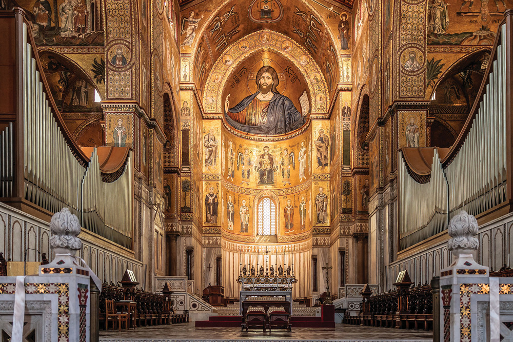 Arab, Byzantine, and Norman craftsmen worked on the cathedral lending to its fusion of techniques and religious symbolism. eFesenko / Shutterstock.com