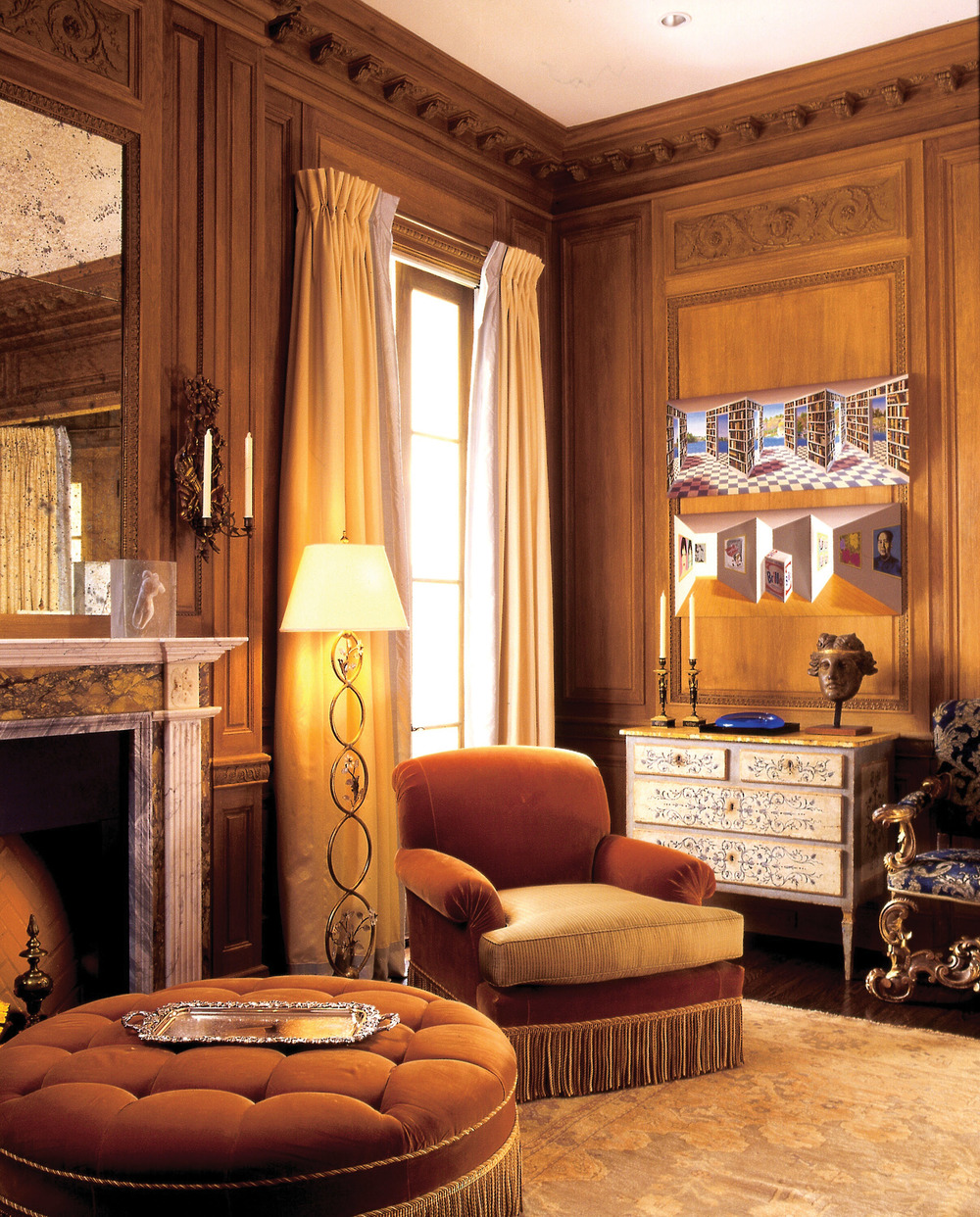 """Couturier made sure the owner's bedroom would be a """"lovely, precious, feminine"""" space where everything felt personal to her. A 17th-century Italian armchair rests beside an Italian late 18th-century chest of drawers. The panelling was made in France from remnants of authentic 18th-century French panelling."""