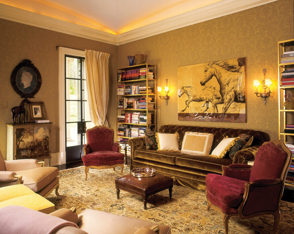 In the library, a 19th-century Persian rug underscores French 18th-century armchairs. The sofa and bookshelves were custom-designed and made in France and New York, respectively.