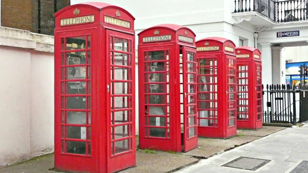 London's classic red phone booth line the street around Pimlico.  (Ben Maloney)