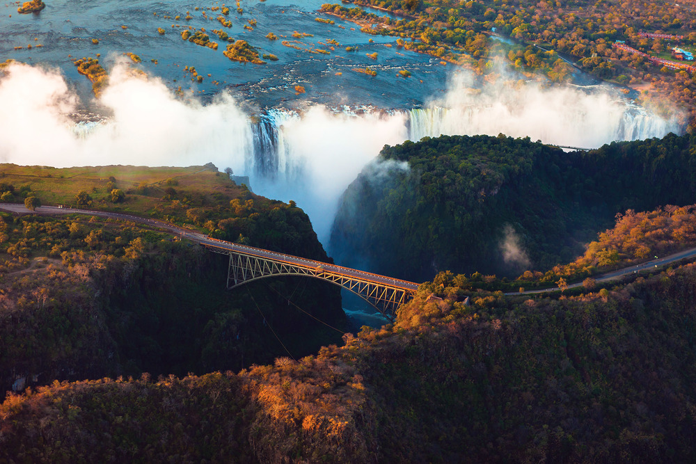 Victoria Falls seen from the sky with the Victoria Falls bridge in the foreground. e2dan / Shutterstock.com